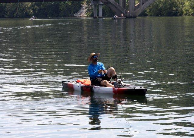 Fishing in Kayak on Lake Taneycomo in Branson MO